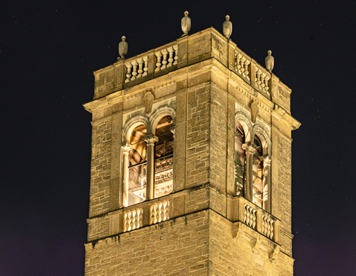 Photo of Carillon Bell Tower outside of the UW-Madison Social Science Building at night.